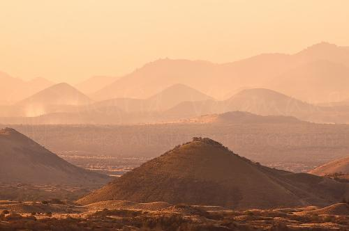 Tsavo West scenery with hills and layers at sunset in Kenya